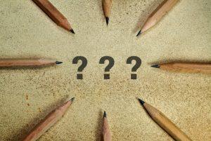 Pencils surrounding question marks